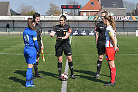 referee Caroline Lanssens with Pauline Windels (5) of Zulte-Waregem and Sien Vandersanden (10) of KRC Genk  pictured during a female soccer game between SV Zulte - Waregem and KRC Genk Ladies on the 2nd matchday in play off 2 of the 2020 - 2021 season of Belgian Scooore Womens Super League , saturday 17 th of April 2021  in Zulte , Belgium . PHOTO SPORTPIX.BE | SPP | DIRK VUYLSTEKE
