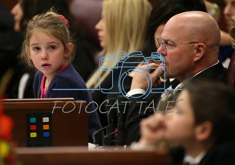 Nevada Assemblyman Ira Hansen, R-Sparks, sits with his granddaughter Lilly Haack, 7, during the opening day of the 77th Legislative Session in Carson City, Nev. on Monday, Feb. 4, 2013. .Photo by Cathleen Allison