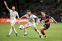 10th February 2021; Bankwest Stadium, Parramatta, New South Wales, Australia; A League Football, Western Sydney Wanderers versus Melbourne Victory; Jake Brimmer of Melbourne Victory under pressure from Graham Dorrans of Western Sydney Wanderers