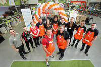 Justin Tipuric and store manager Alex Shevill (C) with members of staff