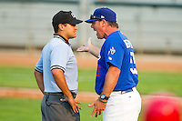 Ogden Raptors manager Damon Berryhill (55) argues a call with umpire Charlie Ramos during the Pioneer League game against the Orem Owlz at Lindquist Field on July 29, 2012 in Ogden, Utah.  The Owlz defeated the Raptors 6-4.   (Brian Westerholt/Four Seam Images)