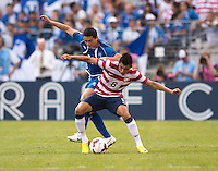 Joe Corona (6) of the United States fights for the ball with Marcelo Posadas Galeano (16) of El Salvador during the quarterfinals of the CONCACAF Gold Cup at M&T Bank Stadium in Baltimore, MD.  The United States defeated El Salvador, 5-1.