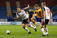 Bolton Wanderers' Antoni Sarcevic competing with Mansfield Town's George Maris (centre) <br /> <br /> Photographer Andrew Kearns/CameraSport<br /> <br /> The EFL Sky Bet League Two - Bolton Wanderers v Mansfield Town - Tuesday 3rd November 2020 - University of Bolton Stadium - Bolton<br /> <br /> World Copyright © 2020 CameraSport. All rights reserved. 43 Linden Ave. Countesthorpe. Leicester. England. LE8 5PG - Tel: +44 (0) 116 277 4147 - admin@camerasport.com - www.camerasport.com