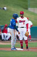 Orem Owlz third baseman Kevin Maitan (9) goofs around with Jeremy Arocho (8) during a Pioneer League game against the Ogden Raptors at Home of the OWLZ on August 24, 2018 in Orem, Utah. The Ogden Raptors defeated the Orem Owlz by a score of 13-5. (Zachary Lucy/Four Seam Images)