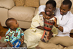 12 month old toddler boy with parents playing musical instruments drums