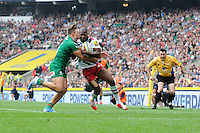 Ugo Monye of Harlequins is tackled by Tom Fowlie of London Irish during the Premiership Rugby Round 1 match between London Irish and Harlequins at Twickenham Stadium on Saturday 6th September 2014 (Photo by Rob Munro)