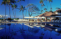 Swimming pool and deck at Halekulani Hotel, which is located on the Waikiki beach front in Honolulu
