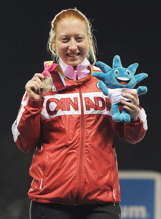 Virginia McLachlan, Guadalajara 2011 - Para Athletics // Para-athlétisme.<br /> Virginia McLachlan after receiving her Silver Medal in the 100m - T38 // Virginia McLachlan après avoir reçu sa médaille d'argent au 100m - T38. 11/17/2011.