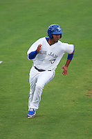 Dunedin Blue Jays second baseman Andy Fermin (23) scores a run during the first game of a doubleheader against the Palm Beach Cardinals on July 31, 2015 at Florida Auto Exchange Stadium in Dunedin, Florida.  Dunedin defeated Palm Beach 7-0.  (Mike Janes/Four Seam Images)