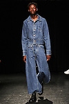 Model Abdulaye walks runway in an outfit from the Linder Spring Summer 2017 collection by Sam Linder and Kirk Millar on July 11 2016, during New York Fashion Week Men's Spring Summer 2017.