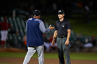 Field umpire Andrew Barrett offers an explanation to Lancaster JetHawks manager Fred Ocasio during a California League game against the Inland Empire 66ers at San Manuel Stadium on May 18, 2018 in San Bernardino, California. Lancaster defeated Inland Empire 5-3. (Zachary Lucy/Four Seam Images)