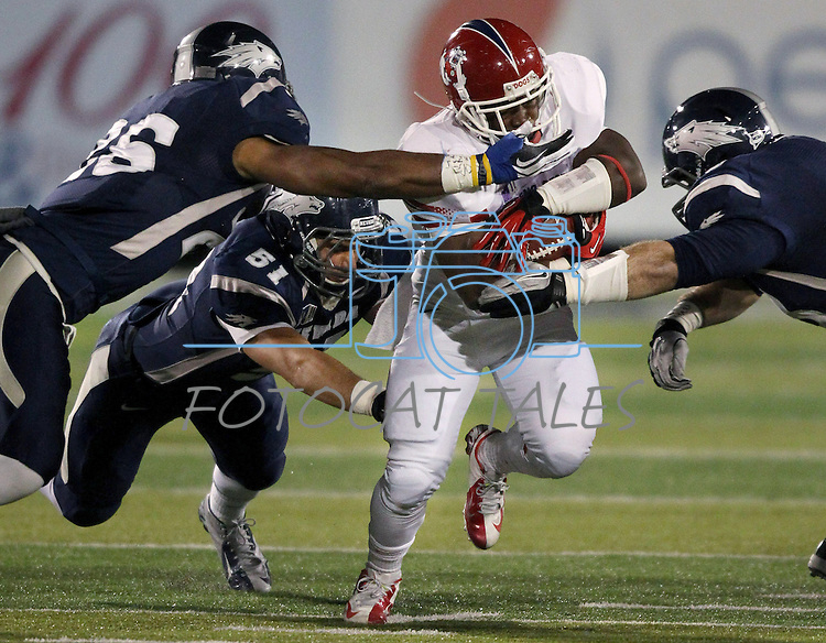 Fresno State's Robbie Rouse (8) attempts to break through Nevada defenders during the first half of an NCAA college football game in Reno, Nev., on Saturday, Nov. 10, 2012. (AP Photo/Cathleen Allison)
