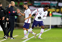 SWANSEA, WALES - NOVEMBER 12: United States head coachGregg Berhalter of the United States along with Sebastian Lletget #17 and Owen Otasowie #14 during a game between Wales and USMNT at Liberty Stadium on November 12, 2020 in Swansea, Wales.