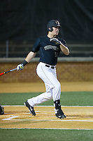 Gavin Sheets (24) of the Wake Forest Demon Deacons follows through on his swing against the Clemson Tigers at David F. Couch Ballpark on March 12, 2016 in Winston-Salem, North Carolina.  The Tigers defeated the Demon Deacons 6-5.  (Brian Westerholt/Four Seam Images)
