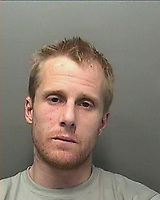 """Pictured: Undated police handout custody picture of Dean Marcus Jones <br /> Re: A Swansea heroin addict has been jailed for 13-and-a-half-years over the death of his girlfriend.<br /> Dean Marcus Jones, 38, pleaded guilty to manslaughter on the first day of his trial at Swansea Crown Court for killing Alison Farr-Davies, 42.<br /> Sentencing, Judge Keith Thomas said her death involved """"a wholly unprovoked and senseless attack"""" in September 2016.<br /> The court had heard the pair's relationship """"involved class A drug use"""".<br /> Jones admitted not seeking medical help soon enough for Miss Farr-Davies after she fell down the stairs of their flat and suffered a serious head injury.<br /> A pathologist also described other injuries such as broken ribs, bite marks and blunt trauma to her face consistent with an assault."""