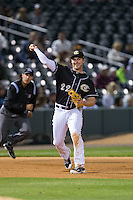 Charlotte Knights third baseman Matt Davidson (22) makes a throw to first base against the Toledo Mud Hens at BB&T BallPark on April 27, 2015 in Charlotte, North Carolina.  The Knights defeated the Mud Hens 7-6 in 10 innings.   (Brian Westerholt/Four Seam Images)