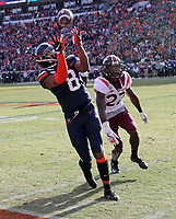 ANDREW SHURTLEFF/THE DAILY PROGRESS <br /> Virginia wide receiver Hasise Dubois (8) hauls in a catch next to Virginia Tech defensive back Armani Chatman (27) during the game Friday in Charlottesville. Virginia defeated Virginia Tech 39-30 to win the Commonwealth Clash.