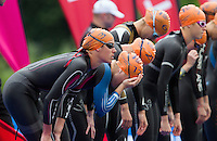 31 MAY 2014 - LONDON, GBR - Helen Jenkins (GBR) (WAL) (left) of Great Britain and Wales prepares to dive into the water at the start of the swim at the elite women's 2014 ITU World Triathlon Series round in Hyde Park, London, Great Britain (PHOTO COPYRIGHT © 2014 NIGEL FARROW, ALL RIGHTS RESERVED)