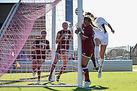 Texas A&M midfielder Janae Cousineau (11) scores with a header on forward Annie Kunz (7) assist during NCAA soccer game, Sunday, October 26, 2014 in College Station, Tex. South Carolina draw 2-2 against Texas A&M in double overtime. (Mo Khursheed/TFV Media via AP Images)