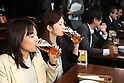 Japanese workers enjoy beer at a promitional event for Premium Friday