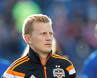Houston Dynamo midfielder Andrew Driver (20). In a Major League Soccer (MLS) match, the New England Revolution (blue/white) defeated Houston Dynamo (orange), 2-0, at Gillette Stadium on April 12, 2014.