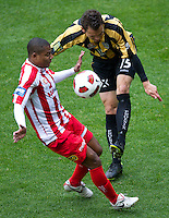 MELBOURNE, AUSTRALIA - SEPTEMBER 19, 2010: Jade North from the Phoenix and Alex Terra from the Heart fight for the ball in Round 7 of the 2010 A-League between the Melbourne Heart and Wellington Phoenix at AAMI Park on September 19, 2010 in Melbourne, Australia. (Photo by Sydney Low / Asterisk Images)