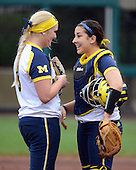 Michigan Wolverines pitcher Megan Betsa (3) talks with catcher Lauren Sweet (25) during the season opener against the Florida Gators on February 8, 2014 at the USF Softball Stadium in Tampa, Florida.  Florida defeated Michigan 9-4 in extra innings.  (Copyright Mike Janes Photography)