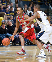 11 November 2009:  Woody Payne of Detroit dribbles the ball away from Jerome Randle of California during the game at Haas Pavilion in Berkeley, California.   California defeated Detroit, 95-61.
