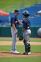 Catcher Harry Ford (20) of North Cobb HS in Kennesaw, GA has a chat with starting pitcher Bubba Chandler (16) of North Oconee HS in Bogart, GA as they play for the Milwaukee Brewers scout team during the East Coast Pro Showcase at the Hoover Met Complex on August 2, 2020 in Hoover, AL. (Brian Westerholt/Four Seam Images)