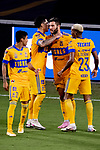 Andre-Pierre Gignac of Tigres UANL (MEX) is congratulated by tema mates after scoring a goal against Javier Portillo of CD Olimpia (HON) during their CONCACAF Champions League Semi Finals match at the Orlando's Exploria Stadium on 19 December 2020, in Florida, USA. Photo by Victor Fraile / Power Sport Images