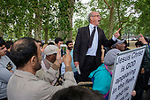 Christian preacher, Speakers' Corner, Hyde Park, London, where the use of video cameras and smartphones to record speakers, preachers, sermons and arguments, for broadcast via social media, has become widespread in recent months.