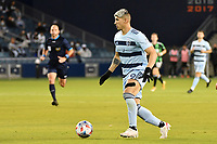 KANSAS CITY, KS - MAY 9: Alan Pulido #9 Sporting KC with the ball during a game between Austin FC and Sporting Kansas City at Children's Mercy Park on May 9, 2021 in Kansas City, Kansas.