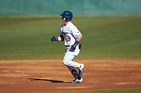 McCann Mellett (9) of the Wingate Bulldogs rounds the bases after hitting a home run against the Concord Mountain Lions at Ron Christopher Stadium on February 2, 2020 in Wingate, North Carolina. The Mountain Lions defeated the Bulldogs 12-11. (Brian Westerholt/Four Seam Images)