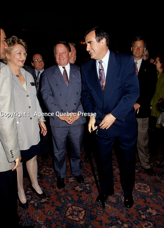 """Montreal (Qc) CANADA - File Photo - May 1996 -<br /> <br /> Lucien Bouchard,  Leader Parti Quebecois (from Jan 29, 1996 to March 2, 2001). seen in a May 1996 file photo with Bernard Landry.<br /> <br /> <br /> After the Yes side lost the 1995 referendum, Parizeau resigned as Quebec premier. Bouchard resigned his seat in Parliament in 1996, and became the leader of the Parti QuÈbÈcois and premier of Quebec.<br /> <br /> On the matter of sovereignty, while in office, he stated that no new referendum would be held, at least for the time being. A main concern of the Bouchard government, considered part of the necessary conditions gagnantes (""""winning conditions"""" for the feasibility of a new referendum on sovereignty), was economic recovery through the achievement of """"zero deficit"""". Long-term Keynesian policies resulting from the """"Quebec model"""", developed by both PQ governments in the past and the previous Liberal government had left a substantial deficit in the provincial budget.<br /> <br /> Bouchard retired from politics in 2001, and was replaced as Quebec premier by Bernard Landry."""