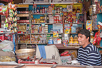 Bodhnath, Nepal.  Store Owner, Vendor of Foodstuffs and Sundries.