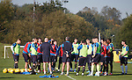 The players gather around and listen to Mark Warburton and David Weir