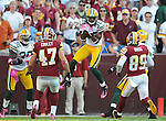 Green Bay Packers cornerback Tramon Williams (38) intercepts Washington Redskins quarterback Donovan McNabb at the end of the fourth quarter of the game at FedEx Field in Landover, Md., on Oct. 10, 2010.