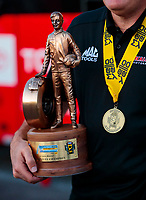 Oct 4, 2020; Madison, Illinois, USA; Detailed view of the Wally trophy and Mello Yello Medal worn by NHRA top fuel driver Doug Kalitta after winning the Midwest Nationals at World Wide Technology Raceway. Mandatory Credit: Mark J. Rebilas-USA TODAY Sports