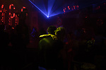 Eva Udayeva, 25, a frequenter visitor of Moscow Marusya, women club dances with a male staff drung a night party. Moscow. Russia. 2014