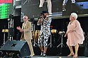 MIRAMAR, FL - AUGUST 22: De Cache Santos (C) and Dancer Filiberto Padron and Celina Fajardo Ganas con Canas perform on stage during the 'Festival Restauracion Dominicana' at Miramar Regional Park Amphitheater on August 22, 2021 in Miramar, Florida.  ( Photo by Johnny Louis / jlnphotography.com )