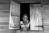 Resident of a wooden house typical of rural areas; Telescope, Grenville.
