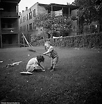 Wilkinsburg PA:  Brady Jr and Helen Stewart playing in the backyard of their Wilkinsburg home.