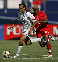 July 24, 2005: East Rutherford, NJ, USA:  USMNT midfielder Landon Donovan (10) is pursued by Albert Blanco (8) of Panama during the CONCACAF Gold Cup Finals at Giants Stadium.