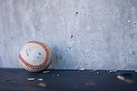 A baseball sits on top of the bench in the Winston-Salem Dash dugout at Wake Forest Baseball Park May 10, 2009 in Winston-Salem, North Carolina. (Photo by Brian Westerholt / Four Seam Images)