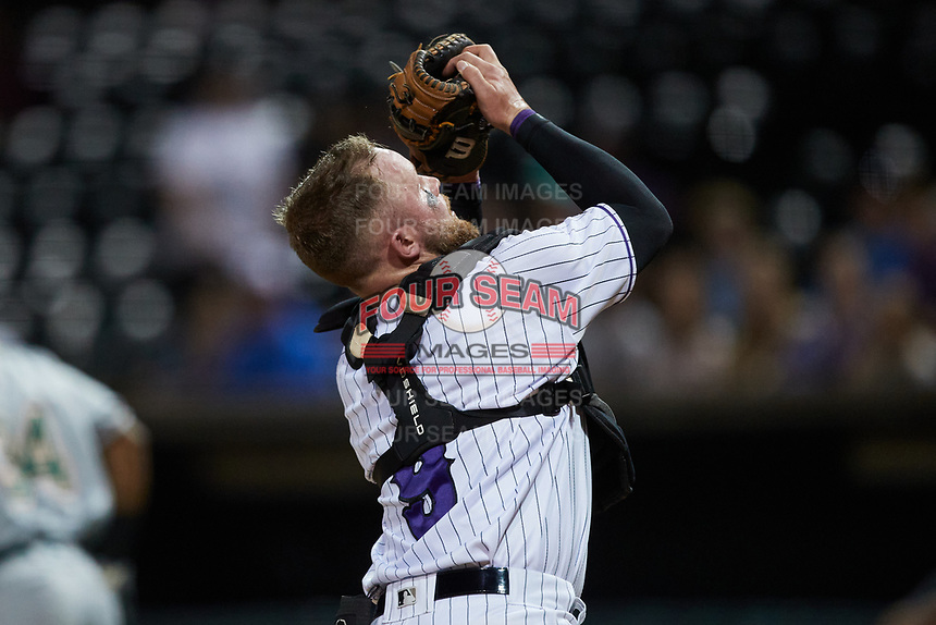 Winston-Salem Dash catcher Evan Skoug (9) catches a pop fly during the game against the Greensboro Grasshoppers at Truist Stadium on June 15, 2021 in Winston-Salem, North Carolina. (Brian Westerholt/Four Seam Images)