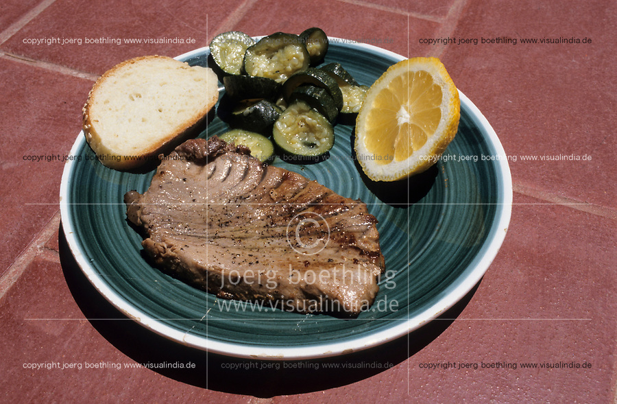 ITALY, Sicily, Palermo, plate with freh Tuna fish steak, Zucchini, bread and lemon