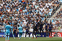 ST PAUL, MN - JULY 18: Emanuel Reynoso #10 of Minnesota United FC with a free kick over the Seattle Sounders FC wall during a game between Seattle Sounders FC and Minnesota United FC at Allianz Field on July 18, 2021 in St Paul, Minnesota.