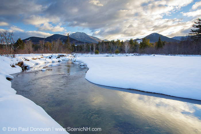 Swift River during the winter months in Albany, New Hampshire. Mount Passaconaway is off in the distance surrounded by clouds.