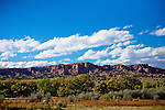 These cliffs rise above the Pojaoque River about 12 miles north of Sante Fe. The nearby Pojoaque Pueblo area inhabitation dates from 500 AD and the Pueblo is one of six Northern Tewa speaking Pueblos.