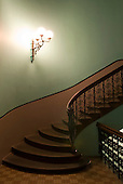 Sydney, Australia. Graceful colonial staircase and wall light bracket.